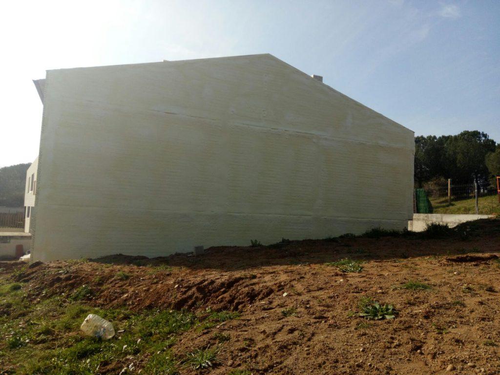 Aislamiento térmico en pared medianera en la localidad de Poliñá.